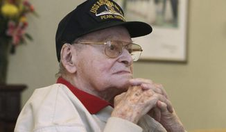 FILE - In this April 20, 2016, file photo, Raymond Haerry sits in West View Nursing & Rehabilitation in West Warwick, R.I. Haerry, one of the last living crew members on the USS Arizona during the Japanese attack on Pearl Harbor, died Sept. 27 in Rhode Island. His remains were interred on the sunken ship on Saturday, April 15, 2017, in Pearl Harbor in Honolulu. (Steve Szydlowski/Providence Journal via AP, File)