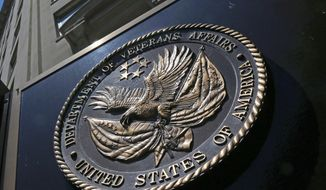 This June 21, 2013, file photo shows the seal affixed to the front of the Veterans Affairs Department building in Washington. (AP Photo/Charles Dharapak, File)