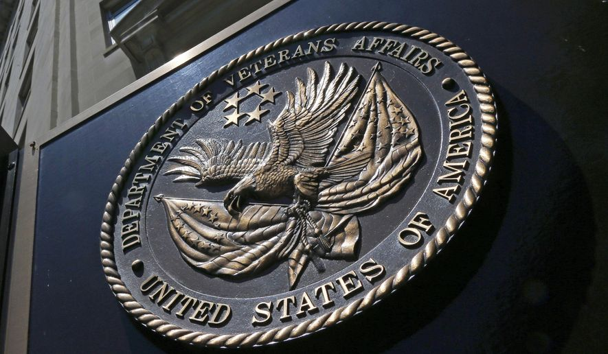 This June 21, 2013, file photo shows the seal affixed to the front of the Veterans Affairs Department building in Washington. (AP Photo/Charles Dharapak) ** FILE **