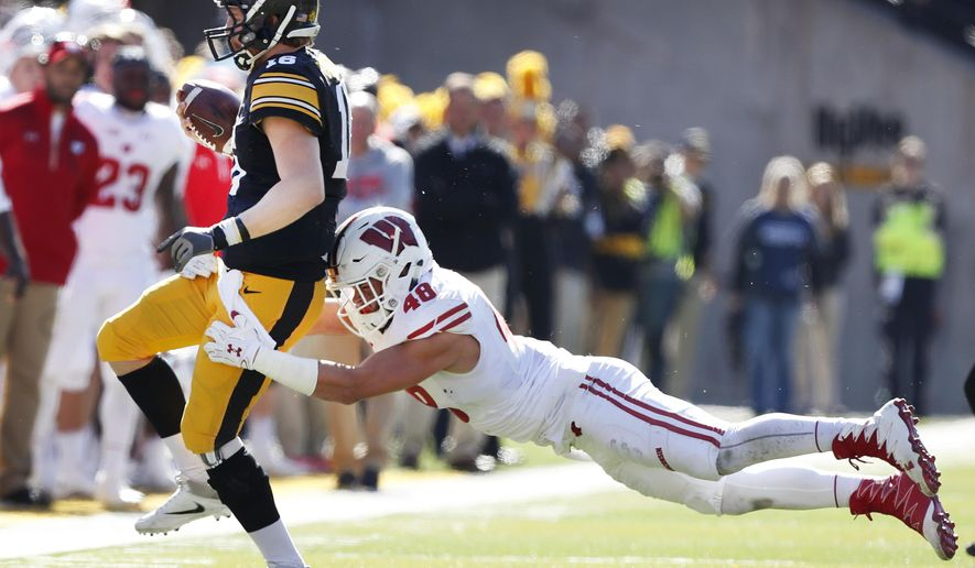 FILE - In this Saturday, Oct. 22, 2016, file photo, Wisconsin linebacker Jack Cichy (48) tackles Iowa quarterback C.J. Beathard during the first half of an NCAA college football game in Iowa City, Iowa. Cichy is back for spring practice at Wisconsin after a breakout 2016 season ended following seven games because of a torn pectoral muscle. The star power in the linebacker corps is moving inside this season with the departures of top outside linebackers T.J. Watt and Vince Biegel. (AP Photo/Charlie Neibergall, File)