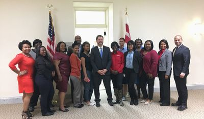 Laura Kelly / The Washington Times   D.C. Council member David Grosso meets with AmeriHealth Caritas D.C.   employees and interns on Wednesday at the Wilson Building.
