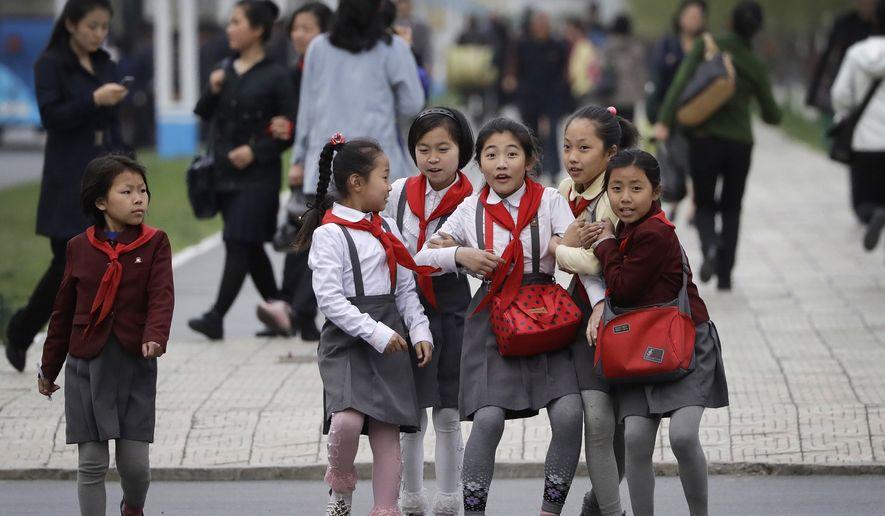 North Korean School Girls React Upon Seeing Their Photograph Being Taken As They Walk Along Mirae