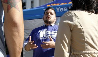 Marcus Ruiz Evans, vice president of the Yes California Independence Campaign, talks to voters about a proposed secession from the United States. (Associated Press/File)