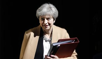 Britain's Prime Minister Theresa May departs 10 Downing Street in London  for Prime Minister's Questions in the Houses of Parliament Wednesday, April 19, 2017.  On Tuesday May announced plans for a snap general election on June 8. (AP Photo/Frank Augstein)