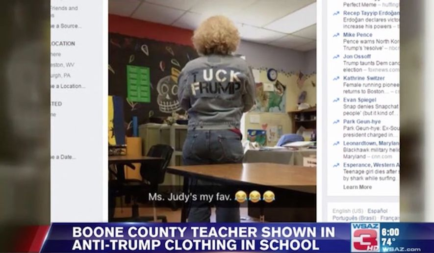 "Cheryl Judy, an art teacher for Sherman Junior and Senior high schools in Boone County, West Virginia, is under fire after she was photographed by a student in class wearing a jacket with the words, ""Tuck Frump,"" emblazoned on the back. (WSAZ)"