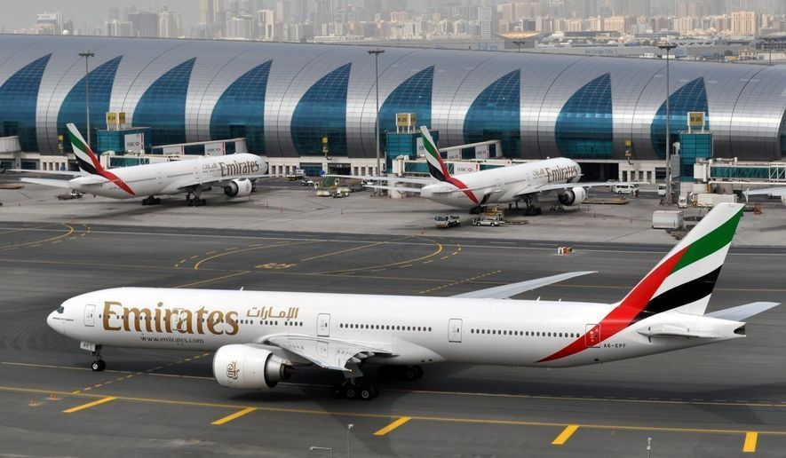 In this Wednesday, March 22, 2017, file photo, an Emirates plane taxis to a gate at Dubai International Airport at Dubai International Airport in Dubai, United Arab Emirates. The Middle East's biggest airline says it is reducing flights to the United States because of a drop in demand caused by tougher U.S. security measures and attempts by the Trump administration to ban travelers from a number of Muslim-majority nations. (AP Photo/Adam Schreck, File)