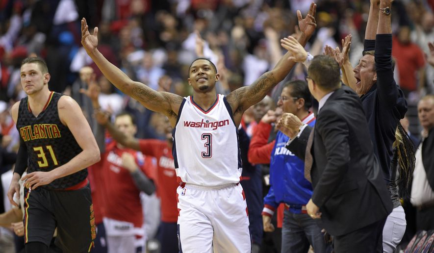 Washington Wizards guard Bradley Beal (3) reacts after he made a 3-point basket during the second half in Game 2 of a first-round NBA basketball playoff series, as Atlanta Hawks forward Mike Muscala runs nearby, Wednesday, April 19, 2017, in Washington. The Wizards won 109-101. (AP Photo/Nick Wass)