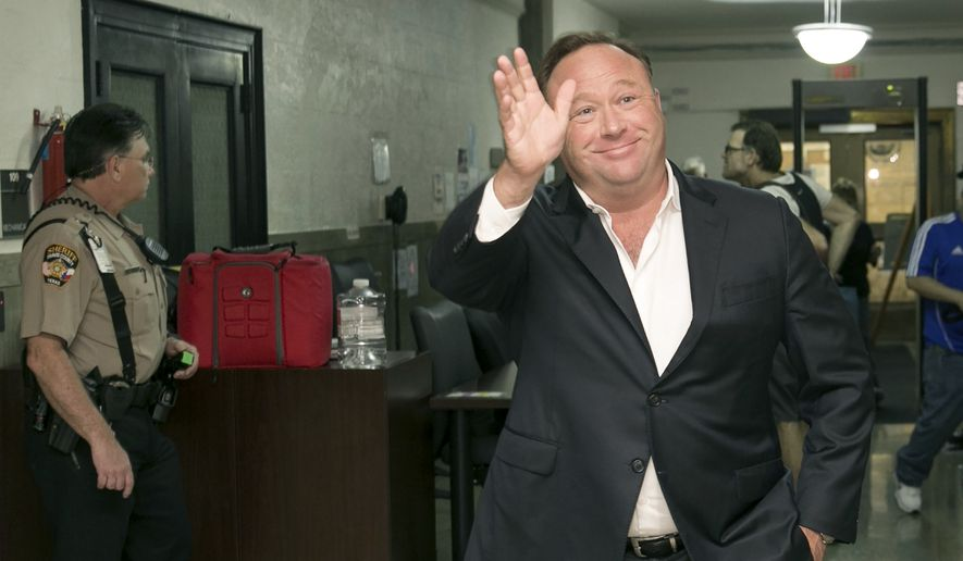 Alex Jones, a right-wing radio host and conspiracy theorist, arrives for a child custody trial at the Heman Marion Sweatt Travis County Courthouse in Austin, Texas, on Wednesday, April 19, 2017. (Jay Janner/Austin American-Statesman via AP) ** FILE **