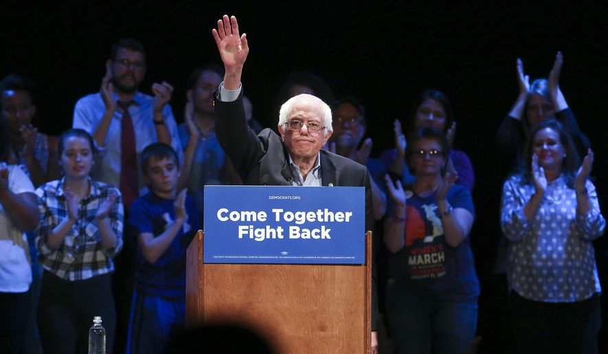 Vermont Sen. Bernie Sanders acknowledges the crowd following his speech at the Louisville Palace, Tuesday, April 18, 2017, in Louisville, Ky. Sanders told a boisterous crowd Tuesday night in Louisville that Trump has reneged on his promises to working-class voters. He said Democrats should reach out to disillusioned Trump supporters as the out-of-power party tries to recover from last year's election losses. (Sam Upshaw Jr./The Courier-Journal via AP)