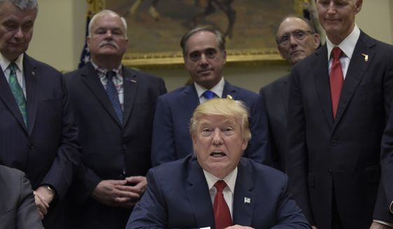 President Donald Trump held a signing ceremony Wednesday for the Veterans Choice Program Extension and Improvement Act. (Associated Press)