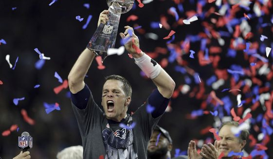 In this Feb. 5, 2017, file photo, New England Patriots' Tom Brady raises the Vince Lombardi Trophy after defeating the Atlanta Falcons in overtime at the NFL Super Bowl 51 football game, in Houston.  (AP Photo/Darron Cummings, File) **FILE**