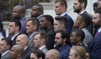 Members of the New England Patriots, including tightend Robert Gronkowski, top center right, listen as President Donald Trump speaks during a ceremony on the South Lawn of the White House in Washington, Wednesday, April 19, 2017, where the president honored the Super Bowl Champion New England Patriots for their Super Bowl LI victory. (AP Photo/Susan Walsh)