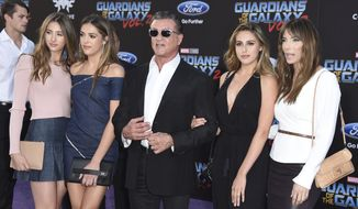 "Scarlet Rose Stallone, from left, Sistine Rose Stallone, Sylvester Stallone, Sophia Rose Stallone and Jennifer Flavin arrive at the world premiere of ""Guardians of the Galaxy Vol. 2"" at the Dolby Theatre on Wednesday, April 19, 2017, in Los Angeles. (Photo by Jordan Strauss/Invision/AP) ** FILE **"