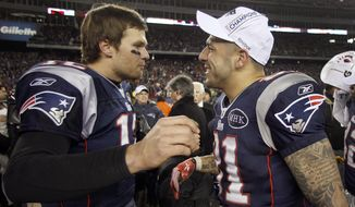 FILE - In this Sunday, Jan. 22, 2012, file photo, New England Patriots quarterback Tom Brady, left, congratulates Aaron Hernandez after their AFC Championship NFL football game against the Baltimore Ravens in Foxborough, Mass. Hernandez, who was serving a life sentence for a murder conviction and just days ago was acquitted of a double murder, died after hanging himself in his prison cell Wednesday, April 19, 2017, Massachusetts prisons officials said. (AP Photo/Charles Krupa, File)