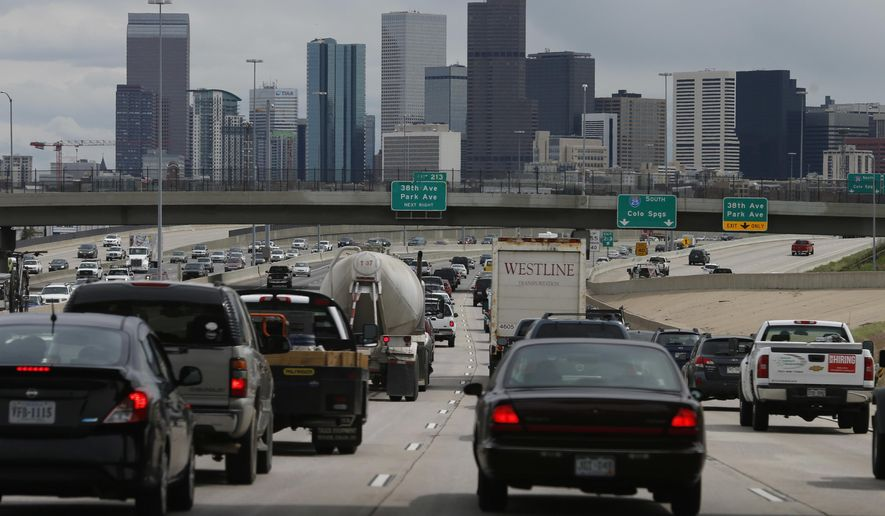 FILE - In this May 27, 2016 file photo, motorists guide their vehicles on Interstate 25, as the skyline of Denver rises in the background. The American Lung Association's 2017 clean air report released late Tuesday, April 18, 2017 says Denver has the nation's 11th-worst ozone levels. (AP Photo/David Zalubowski)