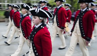 Members of the 3rd U.S. Infantry Regiment Fife and Drum Corp march during opening ceremonies for the Museum of the American Revolution in Philadelphia, Wednesday, April 19, 2017. (AP Photo/Matt Rourke)