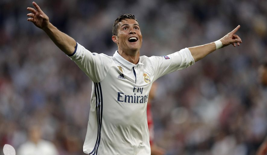 Real Madrid's Cristiano Ronaldo celebrates after scoring his side's third goal during the Champions League quarterfinal second leg soccer match between Real Madrid and Bayern Munich at Santiago Bernabeu stadium in Madrid, Spain, Tuesday April 18, 2017. (AP Photo/Daniel Ochoa de Olza)