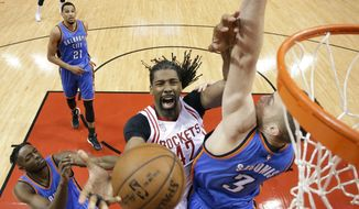 Houston Rockets center Nene Hilario (42) is fouled by Oklahoma City Thunder forward Domantas Sabonis (3) during the first half in Game 2 of an NBA basketball first-round playoff series, Wednesday, April 19, 2017, in Houston. (AP Photo/Eric Christian Smith)