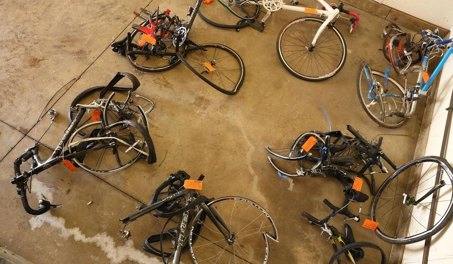FILE- In this  June 9, 2016 file photo, mangled bicycles are tagged as evidence at the Michigan State Police crime lab in Kalamazoo, Mich. The National Transportation Safety Board says better communication between police agencies might have prevented the deaths of five bicyclists last year in southwestern Michigan. A pickup truck plowed into cyclists on a rural road near Kalamazoo last June. The NTSB says 22 minutes passed between the first 911 call about an erratic driver and the crash. The board says Charles Pickett Jr. might have been stopped if dispatchers for three police agencies had shared more information. (Mark Bugnaski/Kalamazoo Gazette-MLive Media Group via AP)