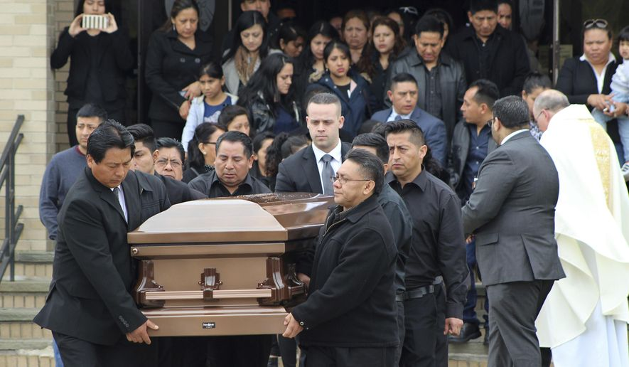 The casket of Justin Llivicura is carried from St. Joseph the Worker Church after Llivicura's funeral Wednesday, April 19, 2017, in East Patchogue, N.Y. Llivicura, 16, was one of four young men found slain in a suspected MS-13 gang killing in a park in Central Islip, N.Y., on April 12. Police have made no arrests in the recent killings, one of 11 suspected gang killings that have occurred on eastern Long Island since September 2016. (AP Photo/Frank Eltman)