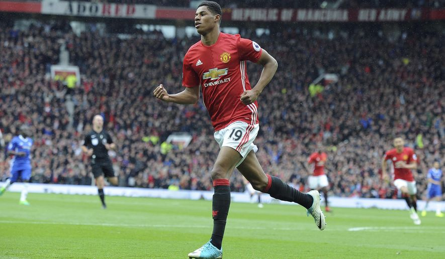 Manchester United's Marcus Rashford celebrates after scoring his side's first goal during the English Premier League soccer match between Manchester United and Chelsea at Old Trafford stadium in Manchester, Sunday, April 16, 2017.(AP Photo/ Rui Vieira)