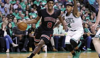 Chicago Bulls guard Rajon Rondo (9) drives towards the basket past Boston Celtics guard Isaiah Thomas (4) during the second quarter of a first-round NBA playoff basketball game in Boston, Tuesday, April 18, 2017. (AP Photo/Charles Krupa)