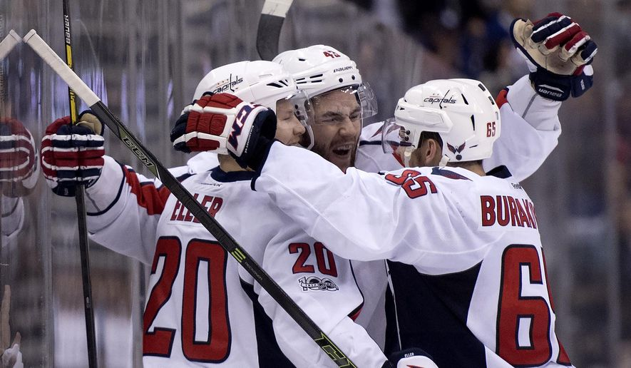 Washington Capitals centre Lars Eller (20) celebrates his goal with teammates Tom Wilson (43) and Andre Burakovsky (65) during first period NHL hockey round one playoff action against the Toronto Maple Leafs, in Toronto on Wednesday, April 19, 2017. (Frank Gunn/The Canadian Press via AP)