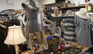 ADVANCE FOR SUNDAY, APRIL 23, 2017- In this April 3, 2017 photo, Alexandra Kaldis Venzke, owner of Sultana's Daughter, works in her shop in Houston. (Brett Coomer/Houston Chronicle via AP)