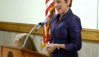 """File- In this 2013 photo, U.S. District Court Judge Patricia Minaldi speaks during the Empowering Women Luncheon in Sulphur, La. Records show a """"caretaker"""" for Minaldi is accused of using her credit cards and checking account to rack up more than $51,000 in debt, including checks purportedly signed by Minaldi while she was getting substance abuse treatment in Florida earlier this year. (Marilyn Monroe/American Press via AP)"""
