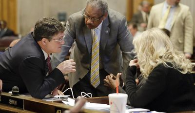 Rep. Mike Stewart, D-Nashville, left, confers with Rep. Larry Miller, D-Memphis, center, and Rep. Sherry Jones, D-Nashville, right, during debate on Gov. Bill Haslam's road and bridge funding bill Wednesday, April 19, 2017, in Nashville, Tenn. (AP Photo/Mark Humphrey)