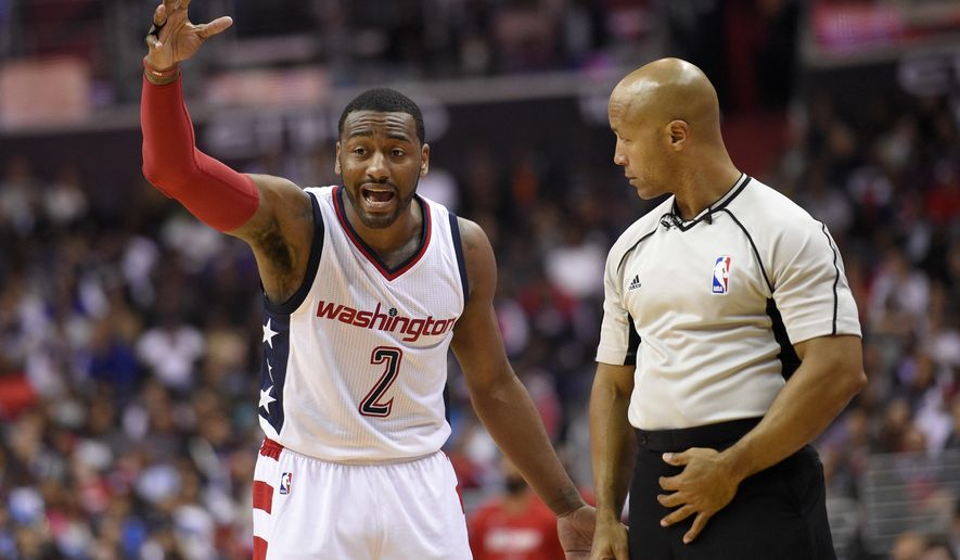 Washington Wizards guard John Wall (2) argues with an official after he was called for a foul during the second half in Game 2 of a first-round NBA basketball playoff series against the Atlanta Hawks, Wednesday, April 19, 2017, in Washington. The Wizards won 109-101. (AP Photo/Nick Wass)