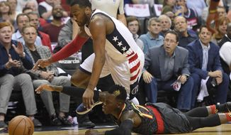 Washington Wizards guard John Wall, top, chases a loose ball against Atlanta Hawks guard Dennis Schroeder, bottom, of Germany, during the first half in Game 2 of a first-round NBA basketball playoff series, Wednesday, April 19, 2017, in Washington. (AP Photo/Nick Wass)