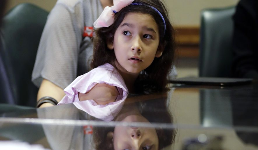 """Libby Gonzales, a transgender girl, sits with her mother Rachel during a news conference held by opponents of a """"bathroom bill"""" at the Texas State Capitol, Wednesday, April 19, 2017, in Austin, Texas. Texas House is considering a bill that's different than one that sparked outcry when it cleared the state Senate last month. (AP Photo/Eric Gay)"""