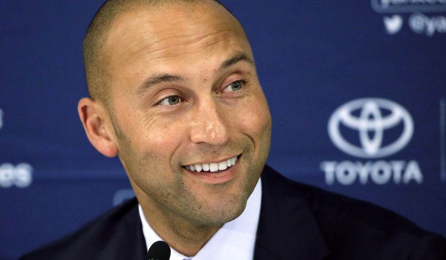 FILE - In this Sept. 28, 2014, file photo, New York Yankees' Derek Jeter speaks to the media after the last baseball game of his career, against the Boston Red Sox, at Fenway Park in Boston. A person familiar with the situation tells The Associated Press that the former Yankees star Derek Jeter and former Florida Gov. Jeb Bush have joined forces in their attempt to buy the Miami Marlins. The person confirmed the partnership on condition of anonymity because Jeter and Bush have not commented .(AP Photo/Steven Senne, File)
