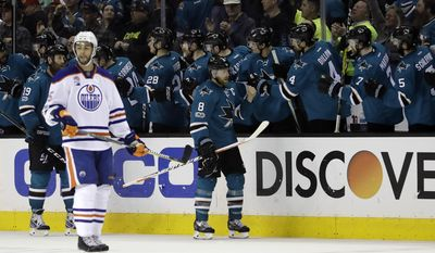 San Jose Sharks center Joe Pavelski (8) celebrates after scoring against the Edmonton Oilers during the second period in Game 4 of a first-round NHL hockey playoff series Tuesday, April 18, 2017, in San Jose, Calif. (AP Photo/Marcio Jose Sanchez)