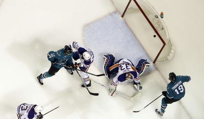 Edmonton Oilers goalie Cam Talbot, center, is beaten for a goal on a shot from San Jose Sharks' Logan Couture, not seen, as Joe Thornton (19), Oilers' Darnell Nurse (25) Sharks' Patrick Marleau (12) and Oilers' Ryan Nugent-Hopkins (93) watch during the first period in Game 4 of a first-round NHL hockey playoff series Tuesday, April 18, 2017, in San Jose, Calif. (AP Photo/Marcio Jose Sanchez)