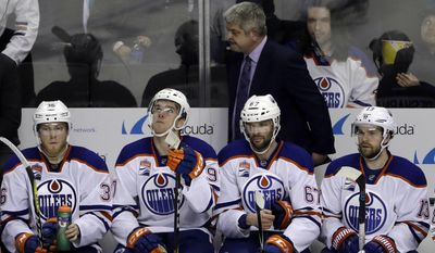 Edmonton Oilers coach Todd McLellan, top, and his players watch from the bench in the closing minutes of a 7-0 loss to the San Jose Sharks in Game 4 of a first-round NHL hockey playoff series Tuesday, April 18, 2017, in San Jose, Calif. (AP Photo/Marcio Jose Sanchez)
