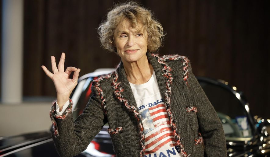 FILE - In this Dec. 10, 2013, file photo, model and actress Lauren Hutton poses for photos after arriving for Chanel's Metiers d'Art fashion show in Dallas. Hutton stars in a new Calvin Klein underwear campaign that debuted on April 18, 2017. (AP Photo/Tony Gutierrez, File)