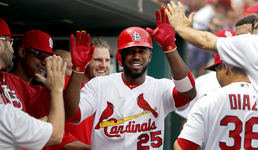 St. Louis Cardinals' Dexter Fowler is congratulated by teammates after hitting a solo home run during the third inning of a baseball game Pittsburgh Pirates Wednesday, April 19, 2017, in St. Louis. (AP Photo/Jeff Roberson)