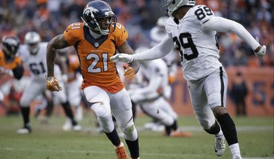 """FILE - In this Jan. 1, 2017, file photo, Denver Broncos cornerback Aqib Talib (21) defends as Oakland Raiders wide receiver Amari Cooper (89) runs a route during an NFL football game in Denver. Members of the Denver Broncos """"No Fly Zone"""" secondary are relieved that Talib won't face a suspension over the shooting in Dallas last year in which the All-Pro cornerback admitted he accidentally shot himself.(AP Photo/Jack Dempsey, File)"""