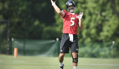 FILE - In this July 28, 2016, file photo, Baltimore Ravens quarterback Joe Flacco throws a pass during practice at the NFL football teams training camp in Owings Mills, Md. A year ago, Flacco was working his way back from knee surgery. Now fully healthy, Flacco is a full participant in the team's offseason conditioning program. (AP Photo/Gail Burton, File)
