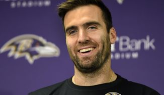 FILE - In this Nov. 27, 2016, file photo, Baltimore Ravens quarterback Joe Flacco smiles as he answers a question during a post game press conference after an NFL football game against the Cincinnati Bengals in Baltimore. A year ago, Flacco was working his way back from knee surgery. Now fully healthy, Flacco is a full participant in the team's offseason conditioning program. (AP Photo/Gail Burton, File)