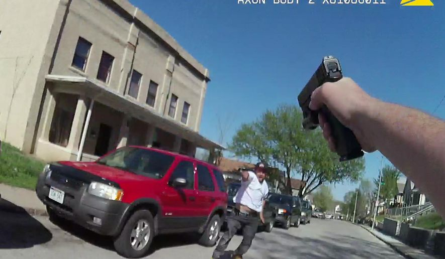 This Monday, April 17, 2017, body camera photo provided by the Omaha Police Department shows Dillon Trejo, a suspect in a convenience store robbery in Omaha, Neb., confronting an Omaha police officer. The Omaha police chief and Douglas County prosecutors said Tuesday, April 18 the officer was justified in shooting Trejo, an unarmed man who reached into his waistband and then simulated bringing a gun to bear on the officer. Trejo was hospitalized after the shooting. (Omaha Police Department via AP)