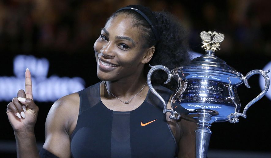 """FILE - In this Jan. 28, 2017, file photo, Serena Williams holds up a finger and her trophy after defeating her sister, Venus, in the women's singles final at the Australian Open tennis championships in Melbourne, Australia. A spokeswoman for Williams says the tennis star is pregnant. Kelly Bush Novak wrote in an email to The Associated Press on Wednesday, April 19, 2017: """"I'm happy to confirm Serena is expecting a baby this Fall.""""  Earlier in the day, Williams posted a photo of herself on the social media site Snapchat with the caption """"20 weeks."""" (AP Photo/Aaron Favila, File)"""