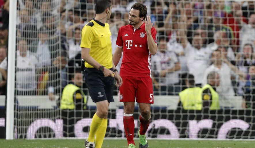 Bayern's Mats Hummels argues with Referee Viktor Kassai after Real Madrid scored their second goal during the Champions League quarterfinal second leg soccer match between Real Madrid and Bayern Munich at Santiago Bernabeu stadium in Madrid, Spain, Tuesday April 18, 2017. (AP Photo/Daniel Ochoa de Olza)