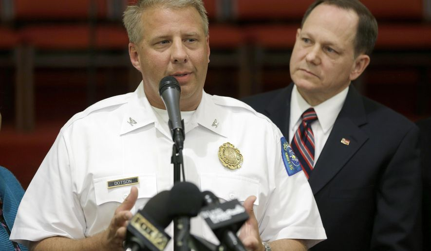 FILE - In this Aug. 20, 2015, file photo, St. Louis Police Chief Sam Dotson, left, appeals for calm alongside Mayor Francis Slay in St. Louis following the death of a black 18-year-old who was fatally shot by police. Newly elected Mayor Lynda Krewson announced Wednesday, April 19, 2017 that Dotson, who presided over the police department through the often tumultuous period since the police shooting of Michael Brown in nearby Ferguson, Mo., is retiring. (AP Photo/Jeff Roberson, File)