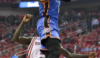 Oklahoma City Thunder guard Russell Westbrook drives past Houston Rockets guard Patrick Beverley during the first half in Game 2 of an NBA basketball first-round playoff series, Wednesday, April 19, 2017, in Houston. (AP Photo/Eric Christian Smith)