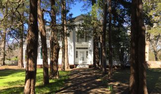 This March 12, 2017 photo shows Rowan Oak, the house where novelist William Faulkner lived with his family in Oxford, Miss. Faulkner bought the property in 1930 and lived there until his death in 1962. Self-guided tours offer visitors a look at furnishings, photos and exhibits about the famed writer, his life and work. (AP Photo/Beth J. Harpaz)