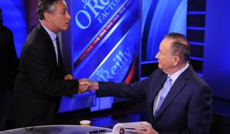"""FILE - In this Sept. 22, 2010 file photo, Jon Stewart, from Comedy Central's """" """"The Daily Show with Jon Stewart,"""" left, shakes hands with Bill O'Reilly during the taping of a segment on """"The O'Reilly Factor,"""" on the FOX News Channel, in New York. (AP Photo/Peter Kramer, File)"""