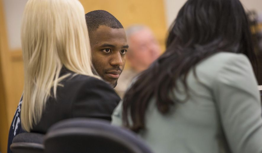 Former Utah State University Linebacker Torrey Green looks on during an evidentiary hearing, Wednesday, April 19, 2017, in Logan, Utah. Judge Brian Cannell ruled Wednesday that there's enough evidence against the former Utah State University football player, accused of sexually assaulting seven women, for the case to go to trial. (Tim Carpenter/Utah Statesman via AP, Pool)
